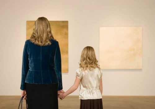 Mother and daughter in art gallery