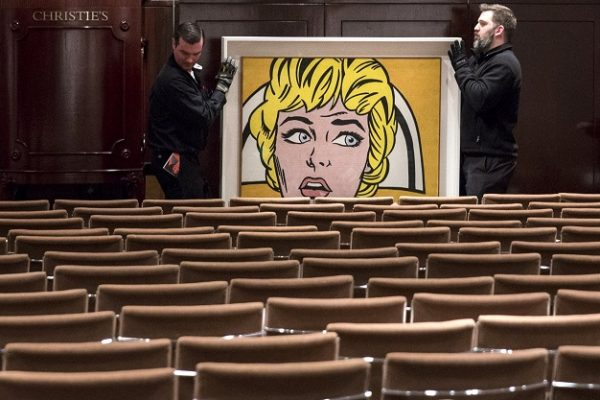"""Workers wheel Roy Lichtenstein's """"Nurse"""" through an emptied auction room following an auction where it sold for $95,365,000.00 at Christie's in Manhattan, New York November 9, 2015. The auction, entitled """"The Artist's Muse"""" featured works by a range of artists including Amedeo Modigliani, Roy Lichtenstein and Paul Gauguin and saw artist auction records set. REUTERS/Andrew Kelly        ATTENTION EDITORS - EDITORIAL USE ONLY. NO RESALES. NO ARCHIVE      TPX IMAGES OF THE DAY"""